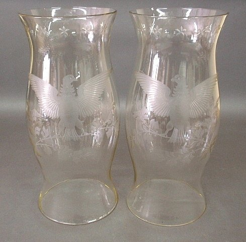 Pair of glass hurricane shades each etched with