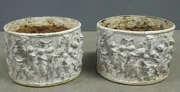 Pair of lead garden planters with relief figural