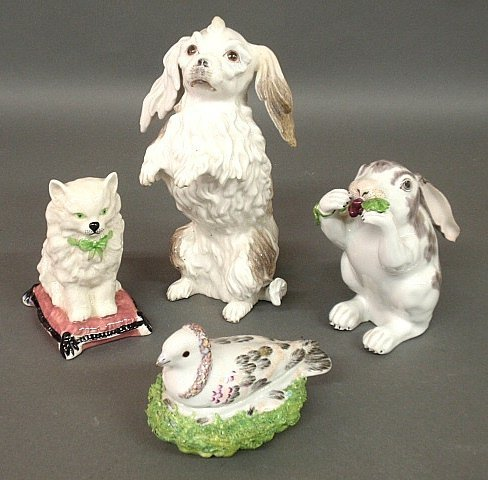 Four English porcelain figures- cat on pillow, spaniel