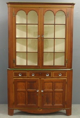 Pennsylvania cherry two-piece corner cupboard, c.1830,
