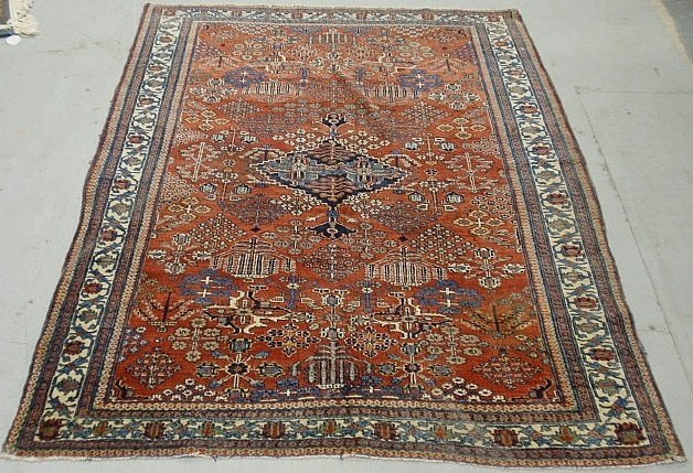 Persian oriental center hall carpet, c. 1900, with a