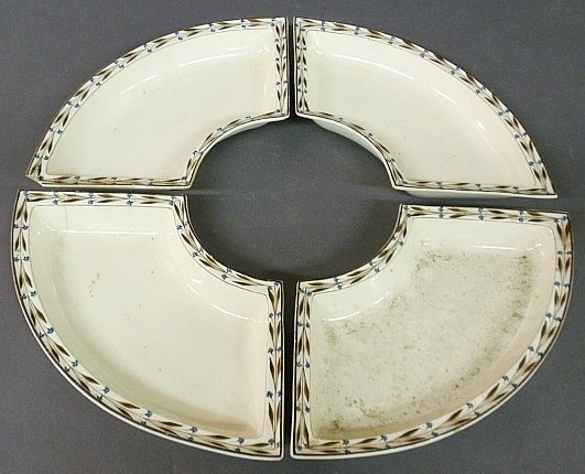 Set of four English creamware crescent shaped dishes, c