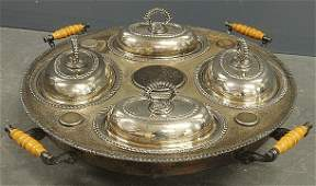 Large round silverplate lazy susan with four covered