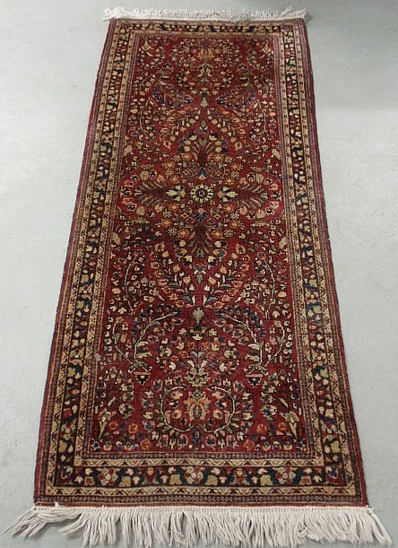 Sarouk oriental hall runner with a red field and