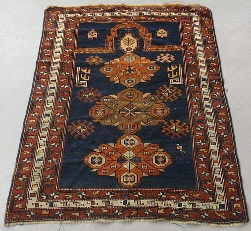Caucasian oriental prayer mat with a blue field and