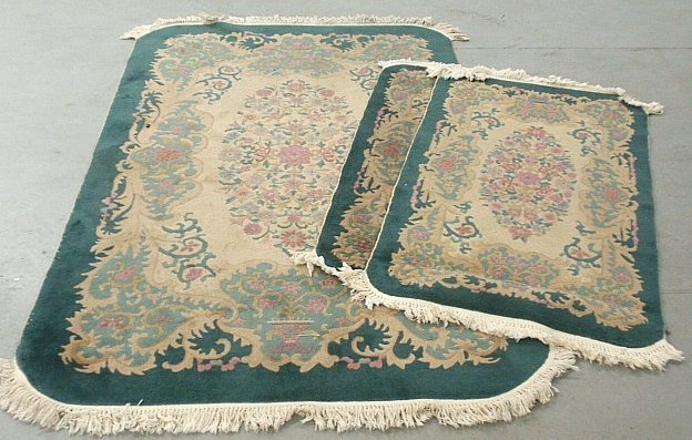 Three green Chinese carpets, largest 8'x5', smaller two