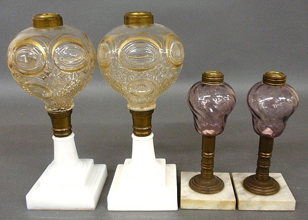 Two pairs of fluid lamps, c.1870, one pair with gilt