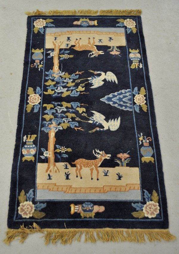 Peking oriental mat with blue field and decorated with