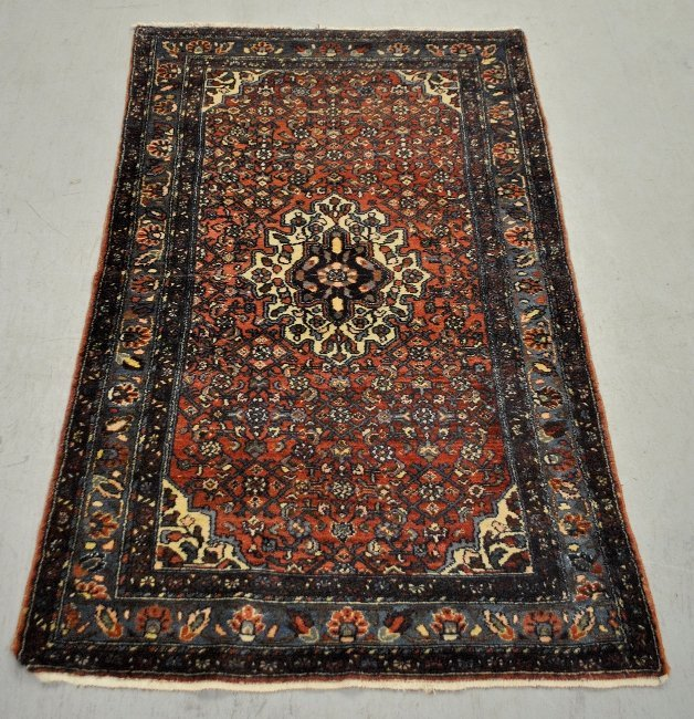 Hamadan oriental center hall carpet with red field,