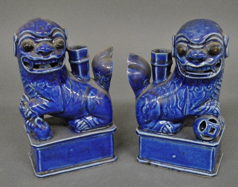 Pair of blue glazed Foo dog candlesticks, probably 18th