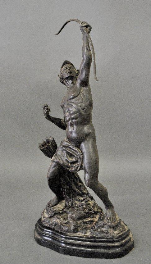 metal statue of Apollo shooting an arrow,