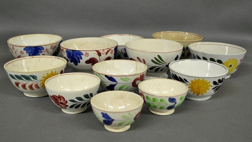 Twelve reproduction Adams Rose bowls, some made in