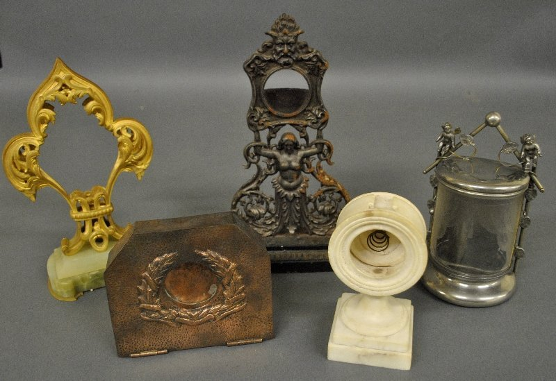 Five watch holders incl. a hammered brass and cast iron