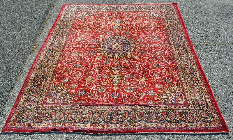 Room size oriental carpet with center medallion