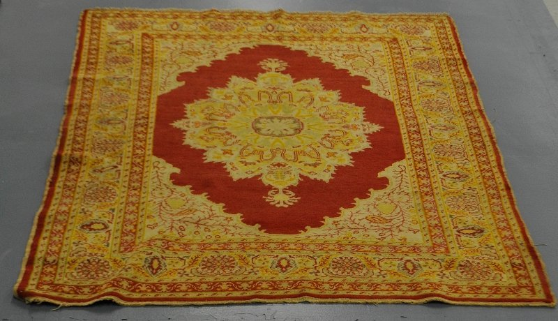 Turkish oriental carpet with a red field and center