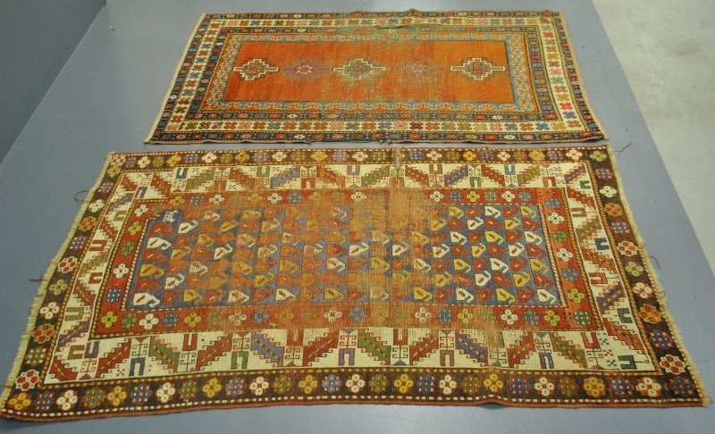 "Two Kazak oriental carpets. As found. 6'7""x4'4""."