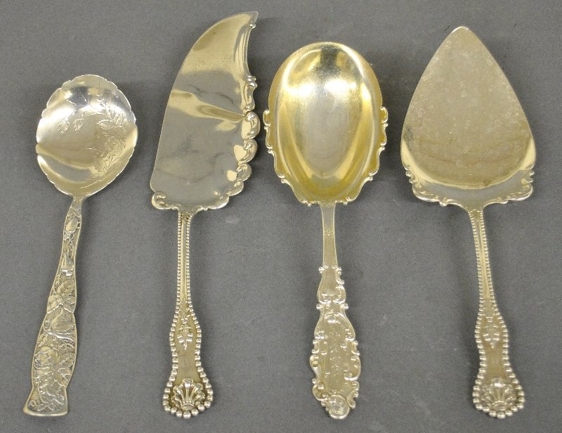 "Four sterling silver serving pieces. Longest is 11""l. 7"