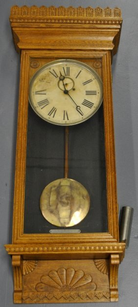 Wm. Gilbert Oak Cased Wall Clock With A Carved Cornice,