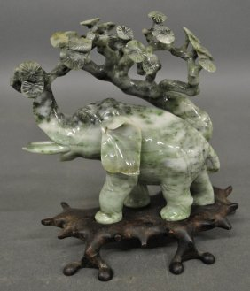 Carved Jade Elephant And A Cherry Tree On A Carved