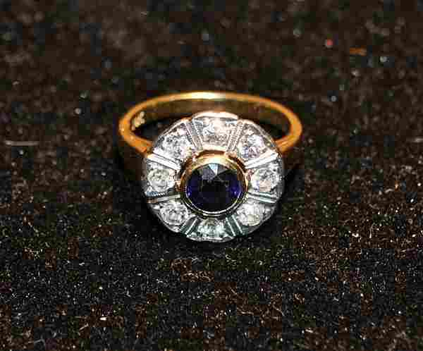 Ladies 14k gold cocktail ring with a center sapphire