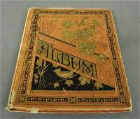 Victorian album full of advertising cards cut outs