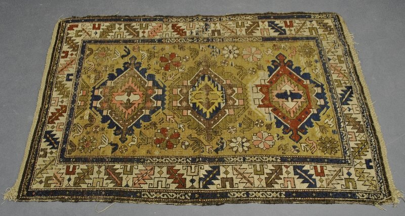 "Kazak antique mat, as found. 3'4""x4'10"""