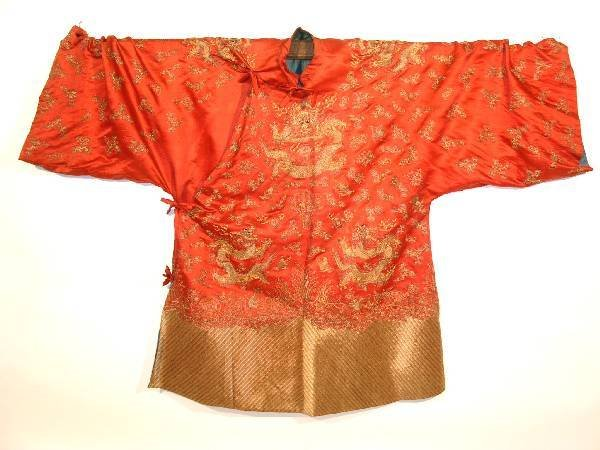 23: Chinese ceremonial robe, early 19th c., red silk wi