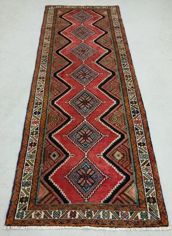 Oriental hall runner with geometric patterns and red