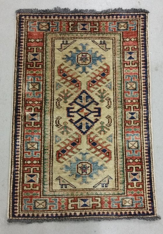 Oriental mat with geometric patterns.  3' x 2'