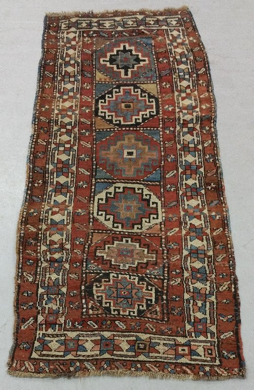 Kazak hall runner with six center medallions and
