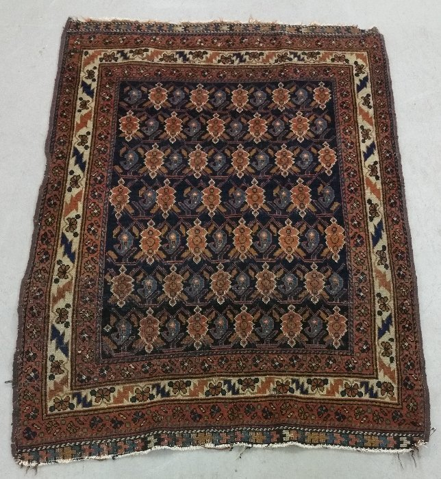 "Persian mat with dark blue field. 4'4"" x 3'1"""