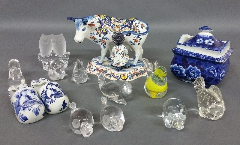 Delft cow, a Staffordshire sugar bowl, crystal animal
