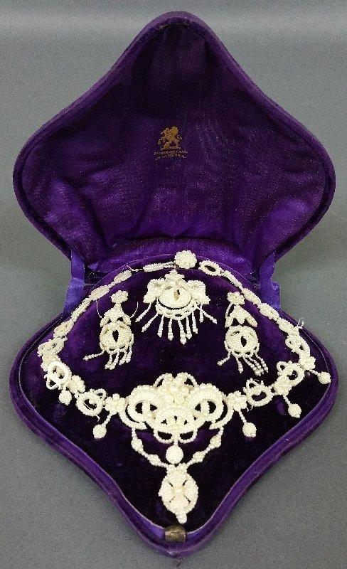 Victorian seed pearl set in original purple box marked
