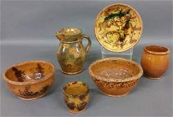 Six pieces of early redware including a bird pie plate
