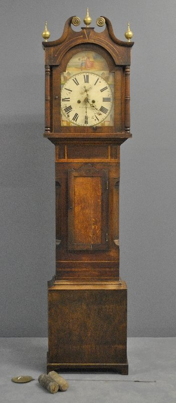 English oak cased eight-day clock, the dial is signed