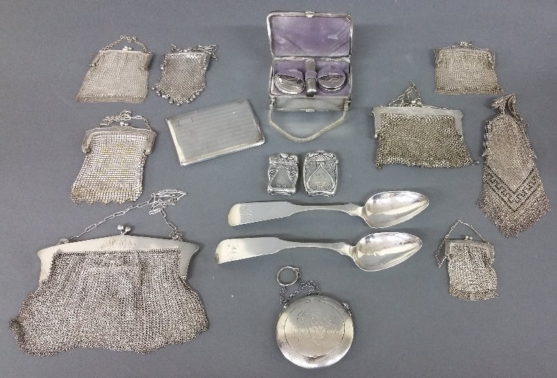 Sterling silver to include a purse/compact, two match