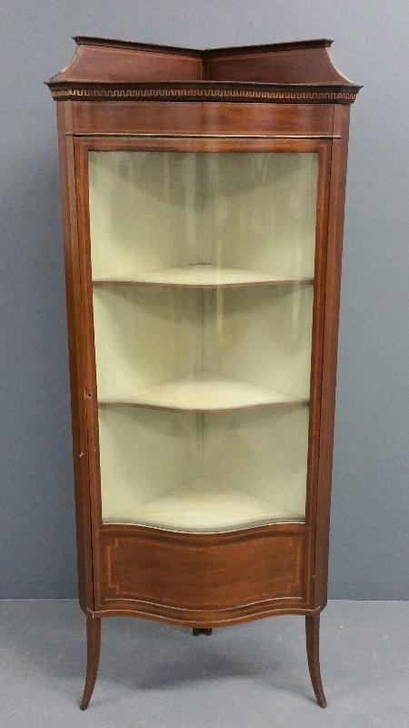 Mahogany inlaid bow-front curio cabinet, circa 1900.