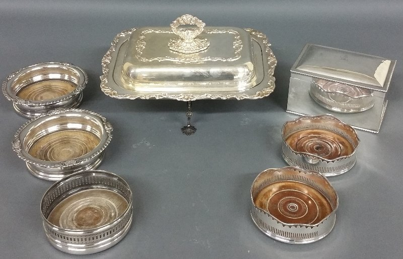 Silverplate coasters, vegetable dish, dish cross, and a