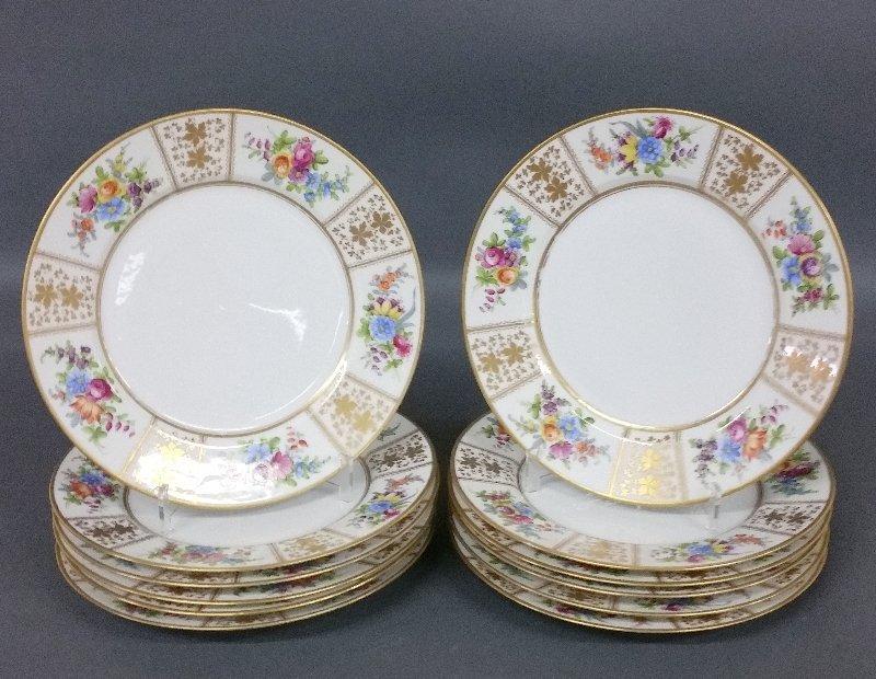 "Set of twelve French porcelain dinner plates. 10 ¼"""