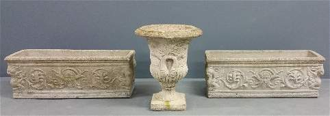 Pair of cement planters together with a cement urn