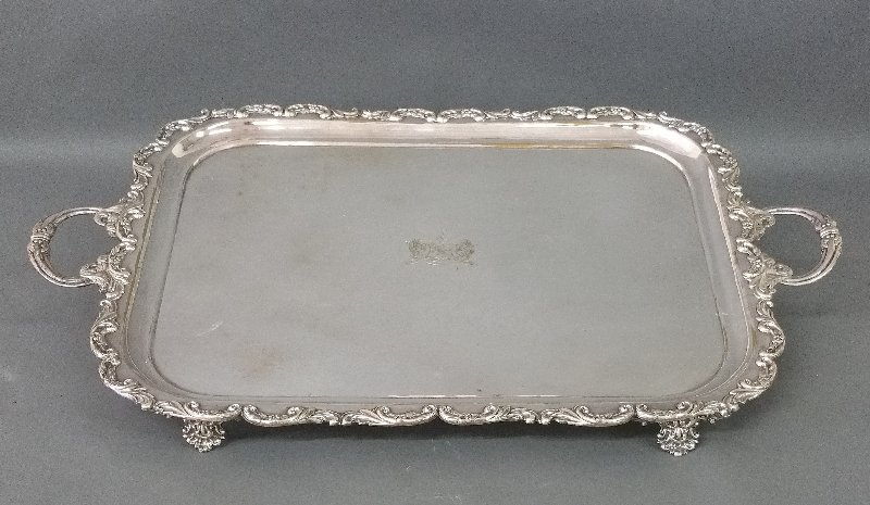Large silver plate serving tray with engraved armorial