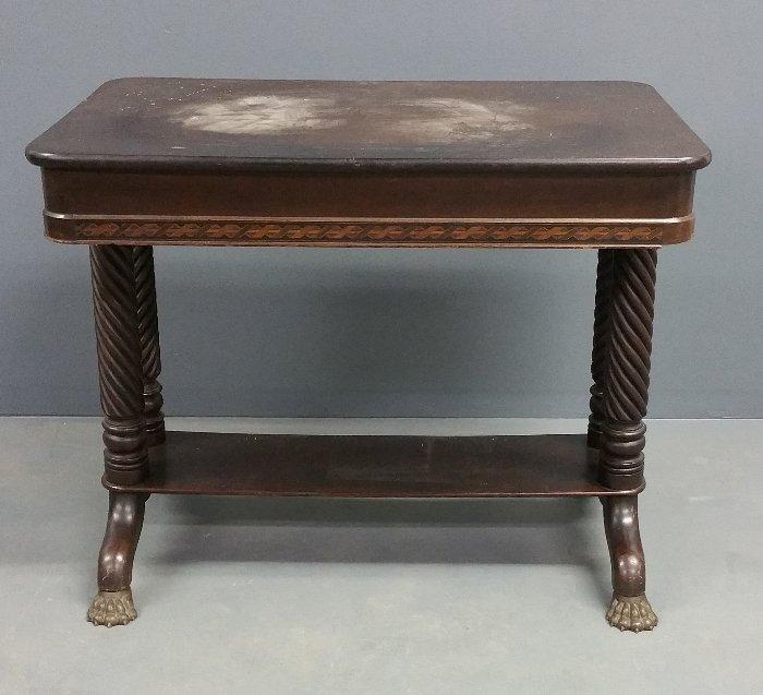 Mahogany library table with paw feet, 19th century. 28