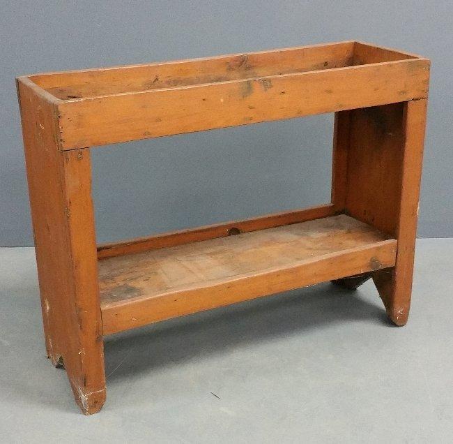 "Primitive pine bucket bench. 30"" h x 38 ½"" w"