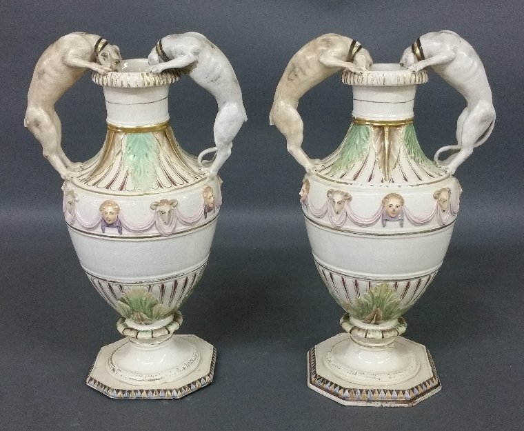 Pair of continental ceramic urns, 19th century. As