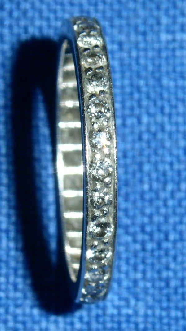 32: Ladies platinum and diamond band, .75 tcw