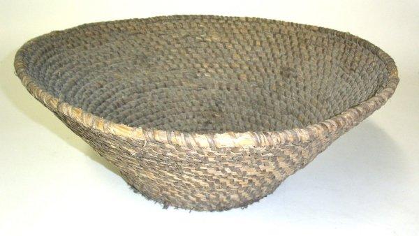 "44: Large rye straw basket. 19.25"" diam.x7.75""h."