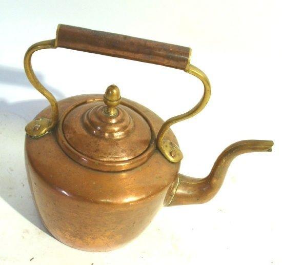 38: Continental brass kettle.