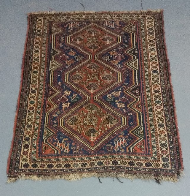 Tribal mat with geometric pattern.  5 feet 4 inches x