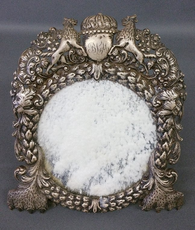 Silverplate repousse table mirror with armorial crest