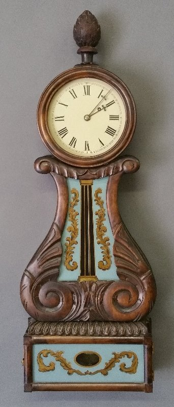 Lyre carved-form banjo clock with carved pine cone